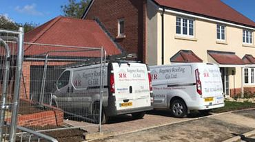 Our Company vans at a completed project